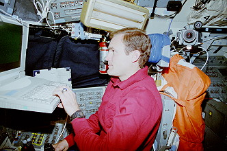 Halsell onboard Space Shuttle